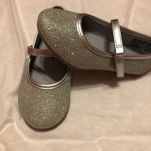 Silver toddler size 7 shoes, cute as a button.